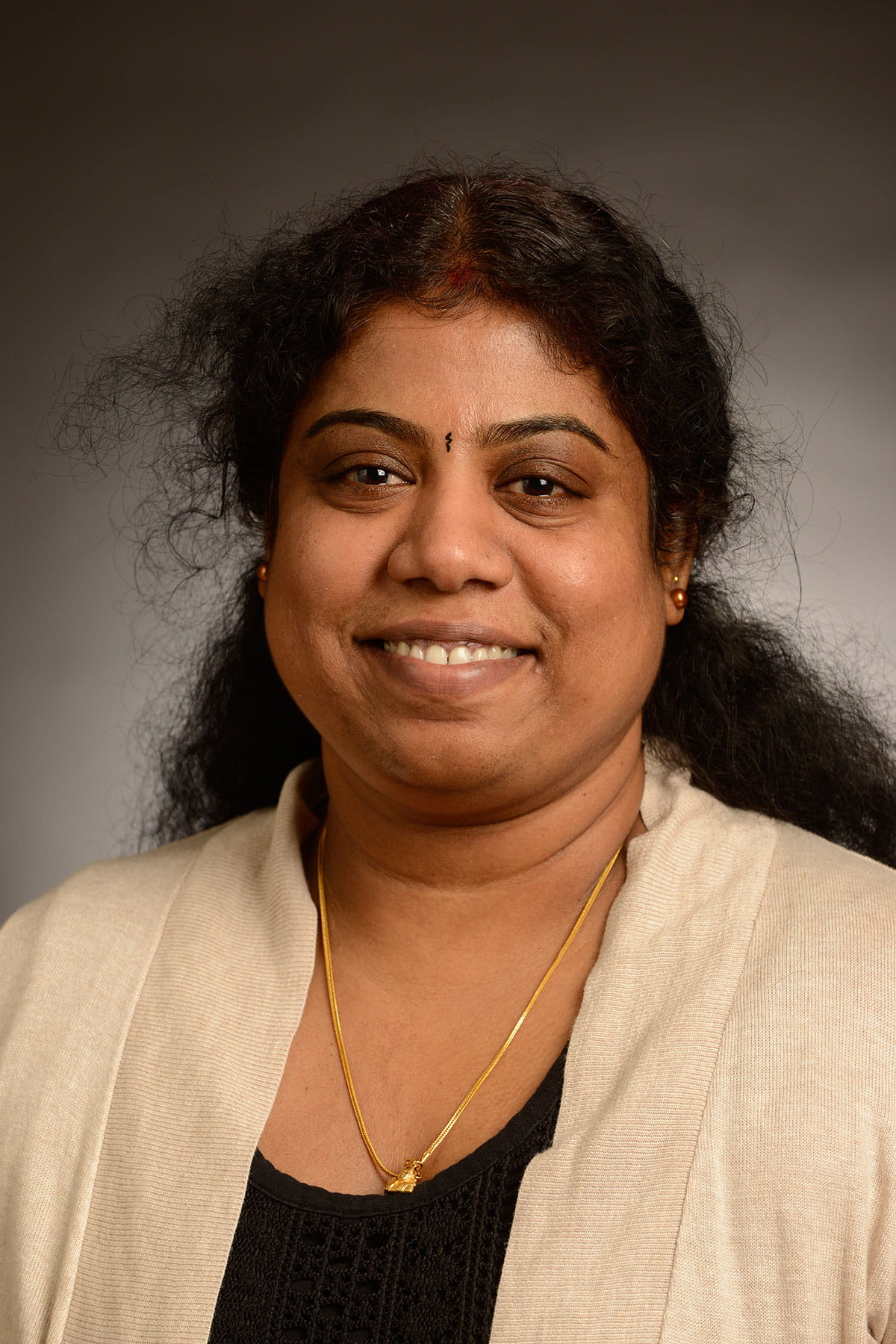 A photo of Paritha Arumugam.