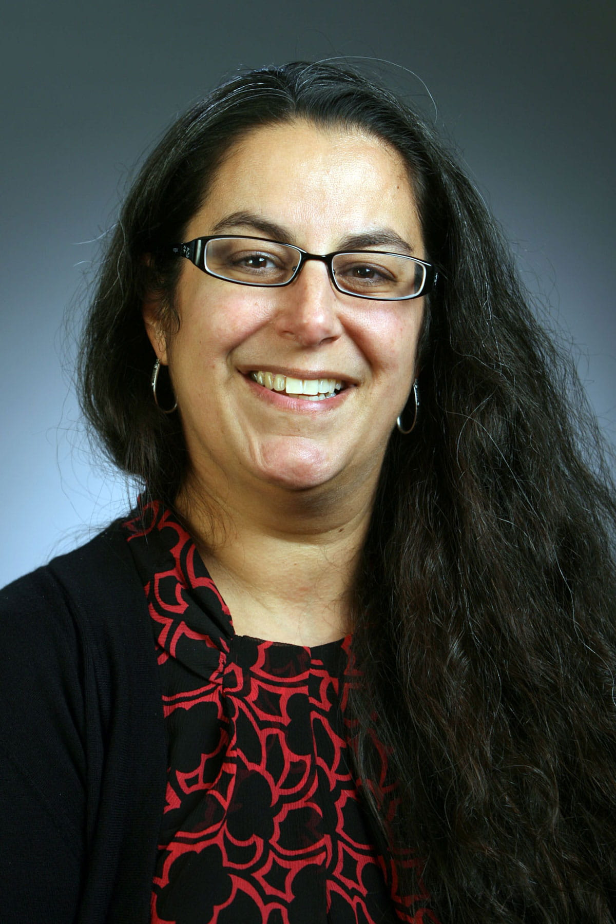 A photo of Mona Mansour.