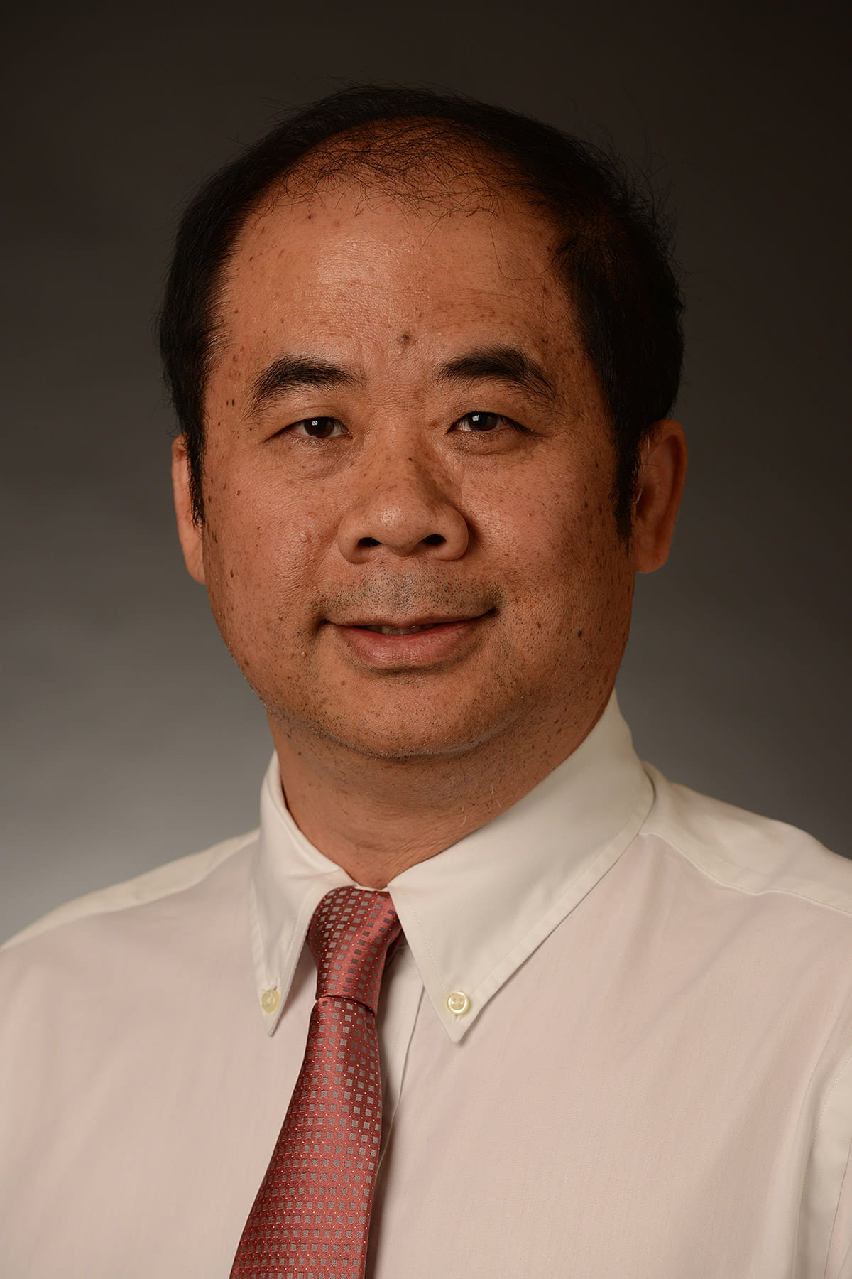A photo of Ming Tan.