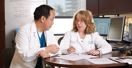 Gastroenterologist Kathleen Campbell, MD, consults with transplant surgeon Greg Tiao, MD.