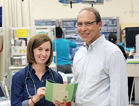 Dr. Erin Hoehn, now a fellow in emergency medicine, with Global Health Residency Track director Dr. Chuck Schubert.