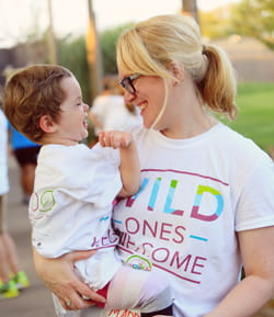 A mom holds her child during the 2016 Cincinnati Walks for Kids event.
