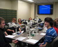 Students using the Pathology lab teaching microscopes