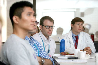 Students attending small group lectures focused on pediatric pulmonary-related clinical topics.