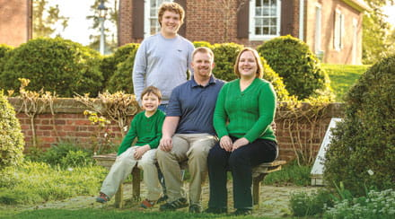 Joy, her sons and husband Mike.