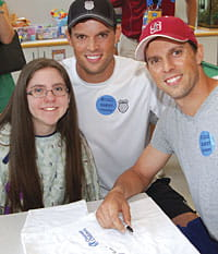 Brooke, a patient in the Cancer and Blood Diseases Institute, met with tennis stars Bob and Mike Bryan during a visit to Cincinnati Children's.