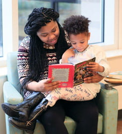 Mom reads with her child.