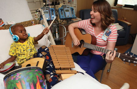 Music therapy in a patient's room.