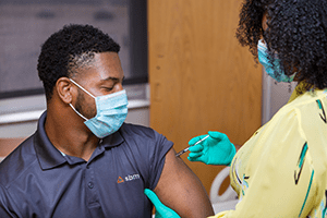 An image of a person receiving a vaccine.