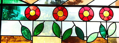 Stained glass window with flowers.