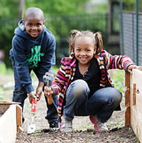 Donovan Clifton and Jayden Turner, both 5, are learning how healthy food grows.