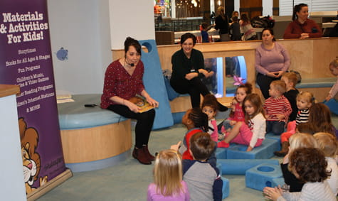 A group of children reading together.