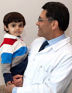 Mohammad, 4, with Dr. Ajay Kaul of Cincinnati Children's.