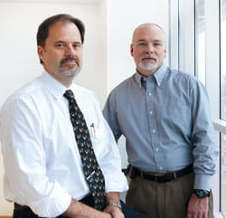 Neurologist Andrew Hershey (left) and psychologist Scott Powers.