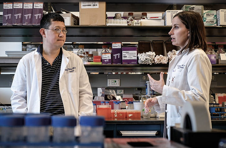 Drs. Sing Sing Way and Elizabeth Schlaudecker in the lab. Learn more about immunity and pregnancy.