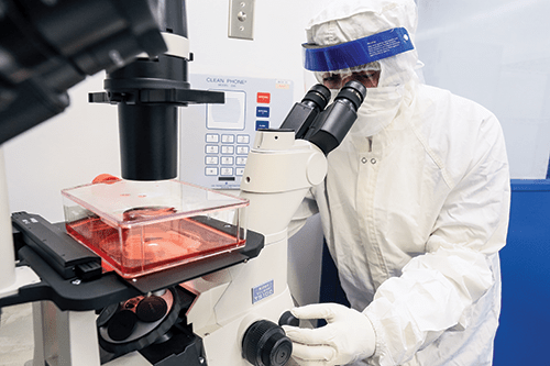 Team members in the Cell Manipulations Laboratory must wear sterile suits while they prepare gene-corrected stem cells for blood or bone marrow transplants.