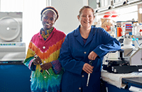 An image of two female researchers working in the lab.