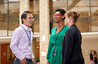 An image of three faculty members talking.