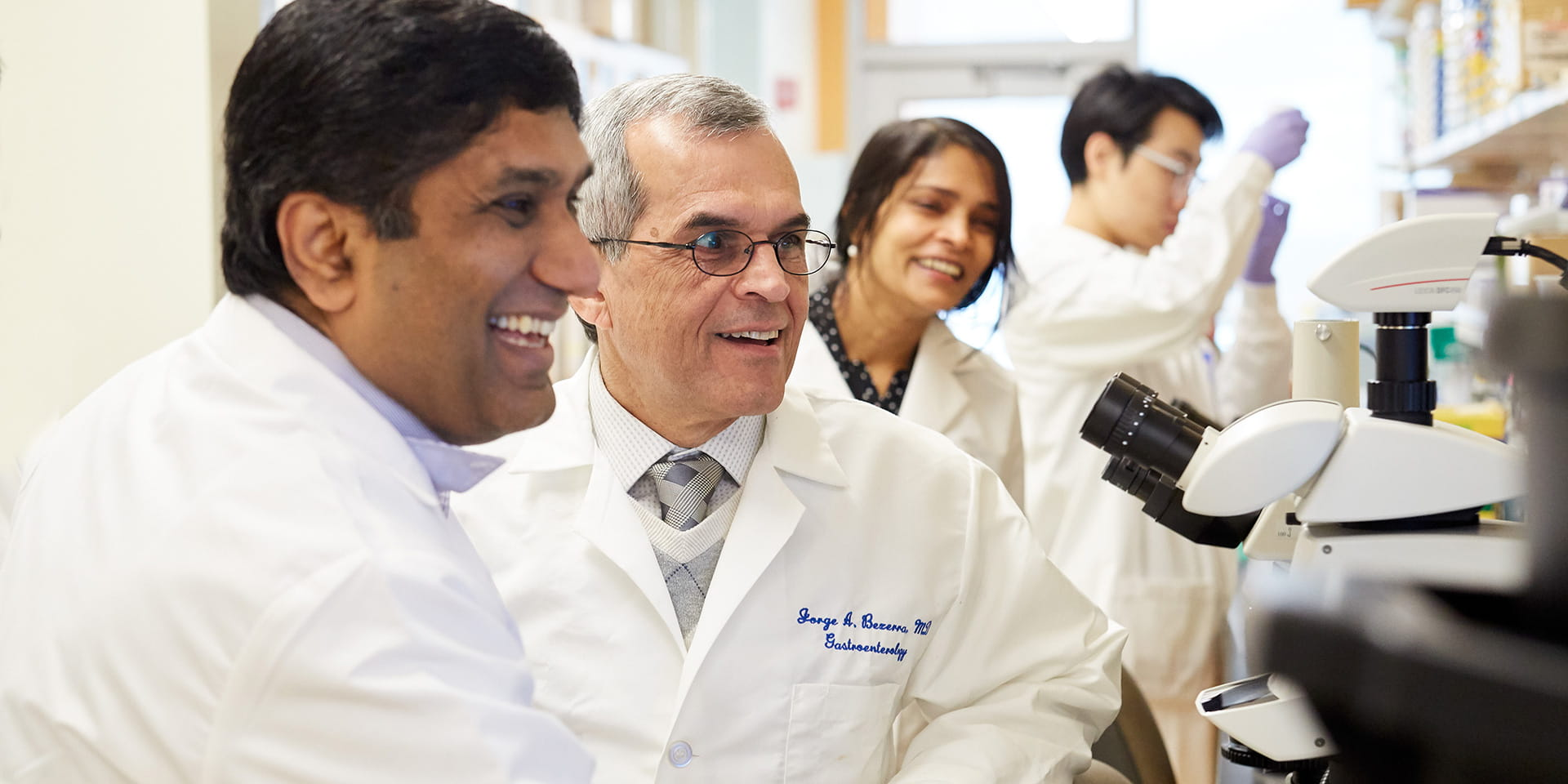 An image of four researchers working in a GI lab.