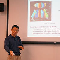Photo of a faculty member presenting at an event hosted by BMI.
