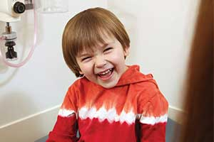cute kid laughing.
