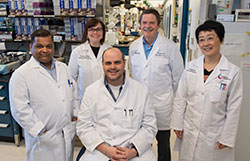 Dr. Singh with his collaborator Dr. Paul Spearman and his team.