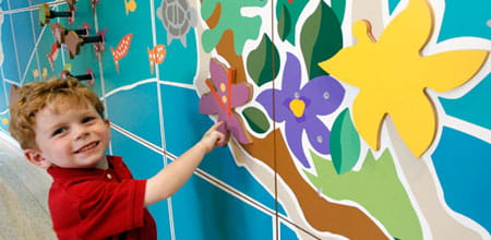 A young patient admires some of the art work at Cincinnati Children's.