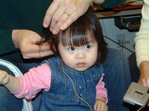 Audiologic testing (hearing evaluations) need to be performed to determine if the child is a candidate for cochlear implantation.