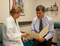 Esophageal Center program director Daniel von Allmen, MD, talks with Marilyn Stoops, RN, MSN, CPNP.
