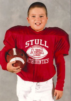 Kenneth in his youth football uniform.