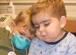 Charles, then 7, comforts William, then 3, in his hospital bed the day before the transplant.
