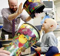 Music Therapist Brian Schreck leads a music therapy session with a patient.