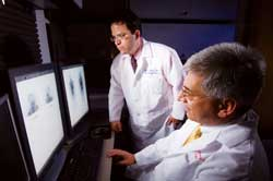John P. Perentesis, MD, FAAP, and Brian D. Weiss, MD, look at MIBG scans.