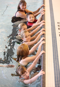 Aquatic wellness classes take place in a group setting.