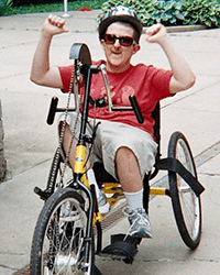 A photo of an RTS patient riding his bike.