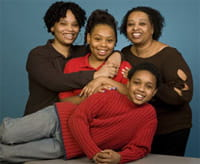 riana Berry (center), 14, is surrounded by her family.