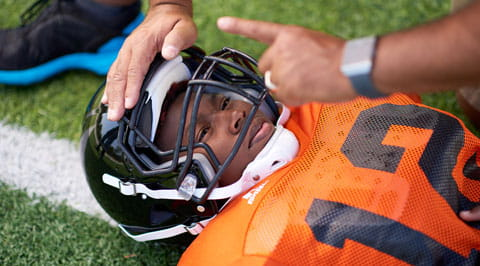 Football player evaluated for a concussion.
