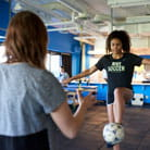Sports medicine patient works on kicking a soccer ball.