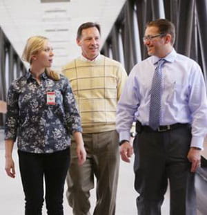 Dr. Rich Falcone (right), Director of Trauma Services at Cincinnat Children's, discusses an upcoming simulation session with Sanford Hospital trauma team members Dr. Scott Engum and Ceann Huber, RN.